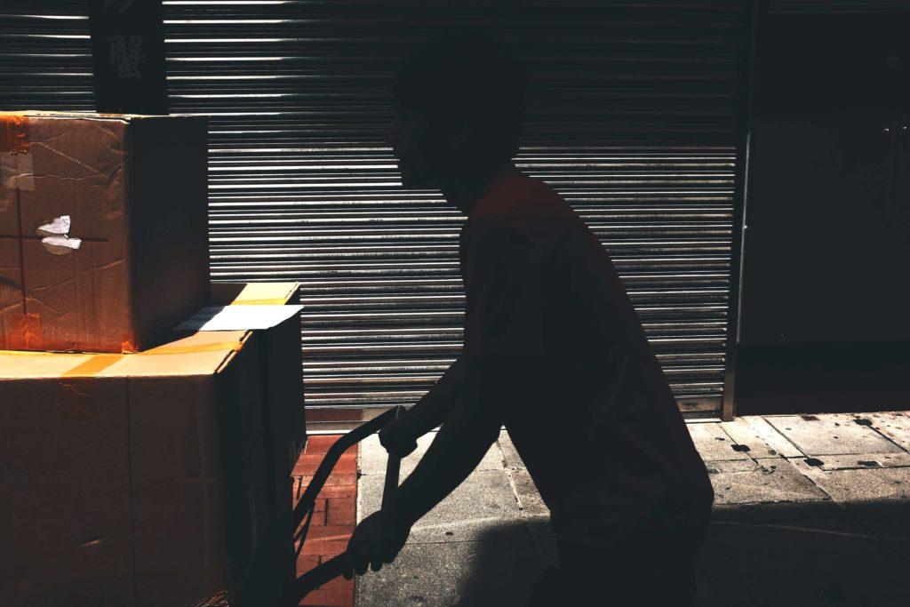 Man movings boxes in bulk