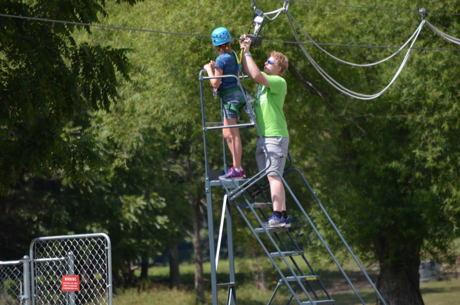 Bible Impact Ministries straps in for a ride on their zipline course.