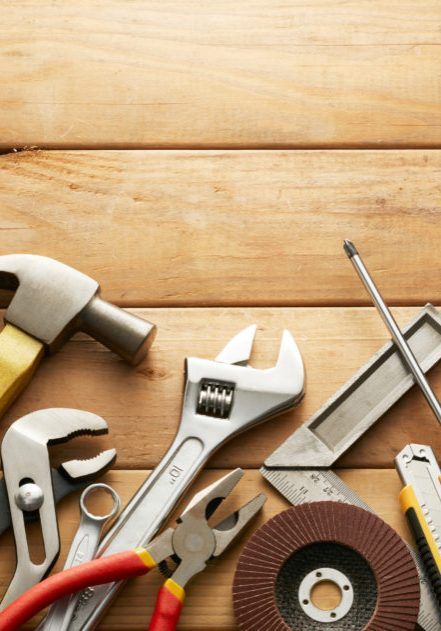 variety of tools on wood planks with copy space
